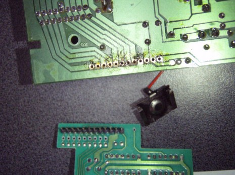 Remove excess solder from the pin holes